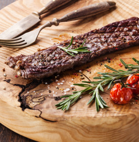 Steak Machete with rosemary, salt and pepper on wooden background