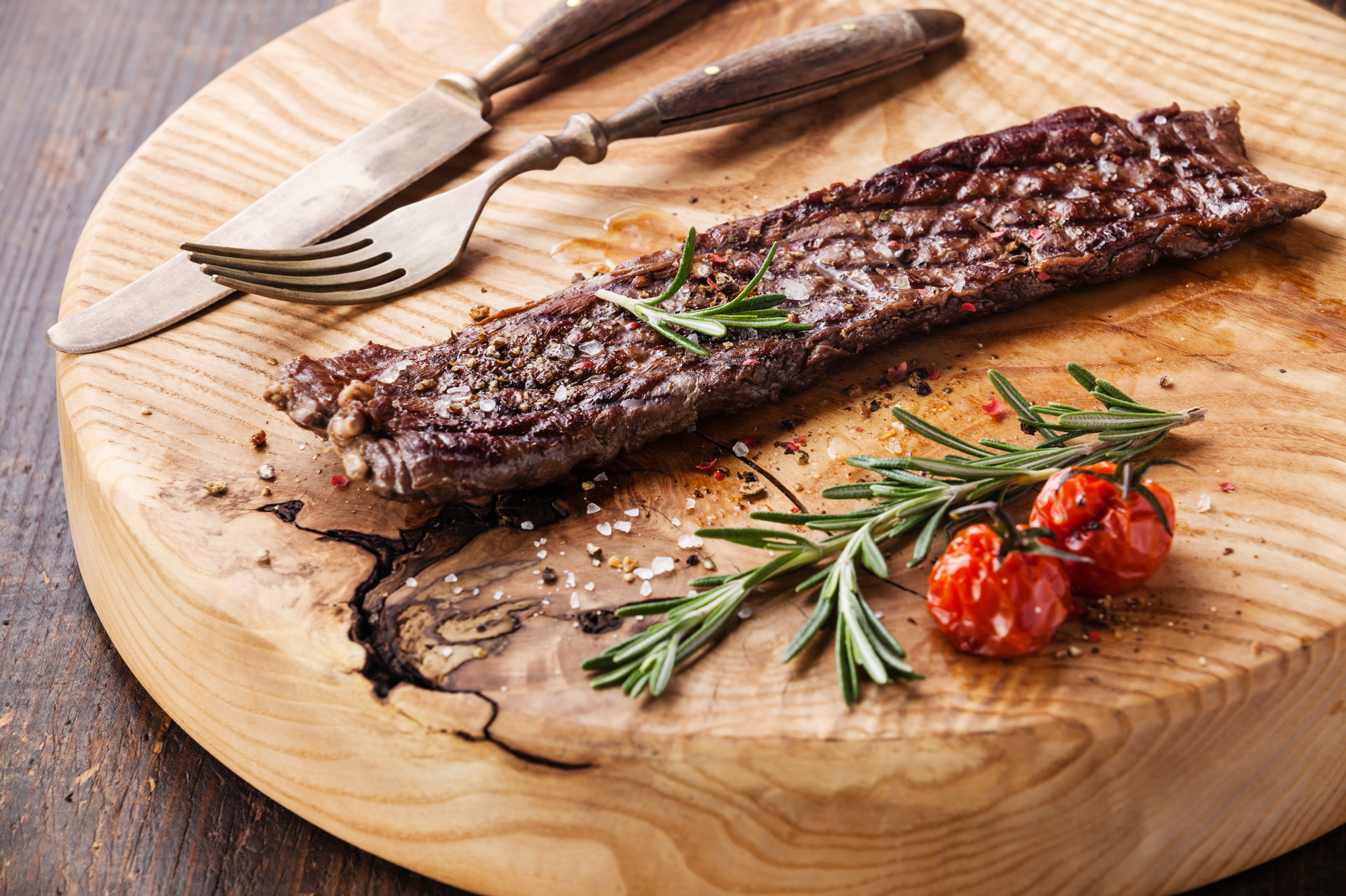 Steak Machete with rosemary, salt and pepper on wooden background