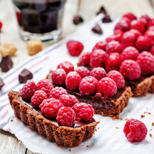 chocolate tart with chocolate filling and fresh raspberries. toning. selective focus
